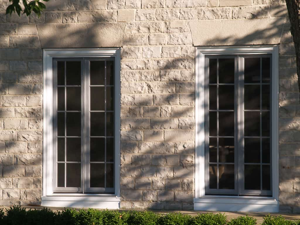 Replacement windows in a limestone building
